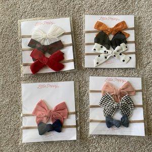 New in packaging Little Poppy Headbands